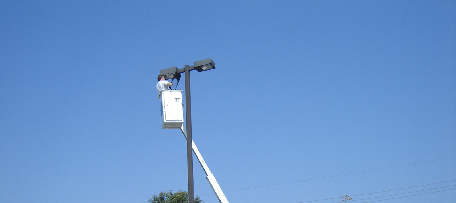 Outdoor parking lot lighting bucket truck